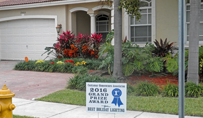 great neighborhood Cutler Bay Christmas decorating winner with sign